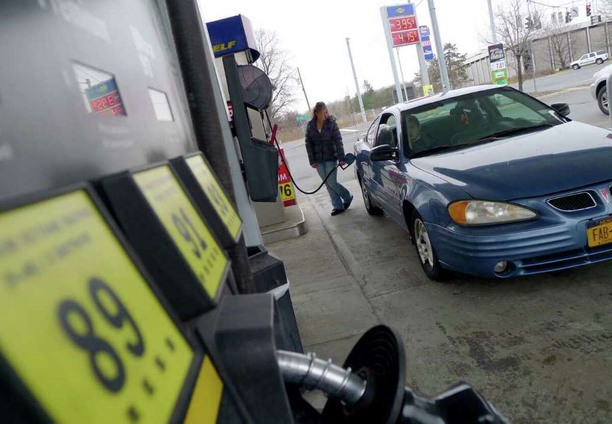 Travelers gas up at the Sunoco on Wolf Road in Colonie, N.Y. Wednesday Feb.29, 2012.( Michael P. Farrell/Times Union)