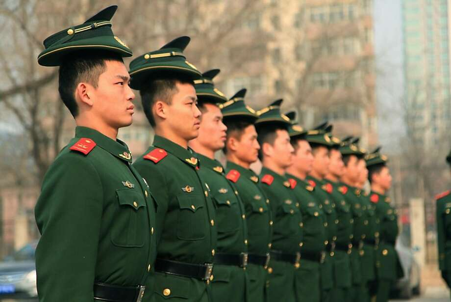 Almost perfect, men. Just one minor detail:Military police officers undergo inspection in preparation for the upcoming National People's Congress in Beijing. Photo: Stringer, AFP/Getty Images