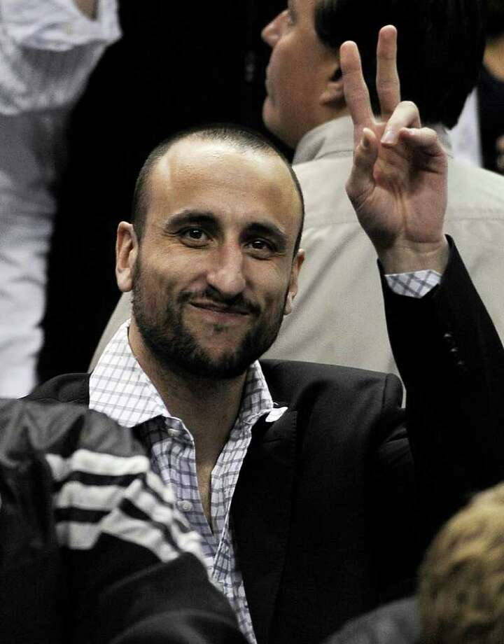 San Antonio Spurs' Manu Ginobili, of Argentina, gestures from behind the bench during the first half of an NBA basketball game against the Chicago Bulls, Wednesday, Feb. 29, 2012, in San Antonio. Photo: AP