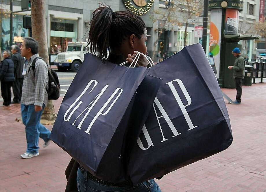 SAN FRANCISCO, CA - DECEMBER 14:  A pedestrian carries shopping bags from a GAP store on Market Street on December 14, 2010 in San Francisco, California.  According to reports February 23, 2012, Gap Inc. has reported a 40 percent drop in profits in their fourth quarter.  (Photo by Justin Sullivan/Getty Images) Photo: Justin Sullivan, Getty Images
