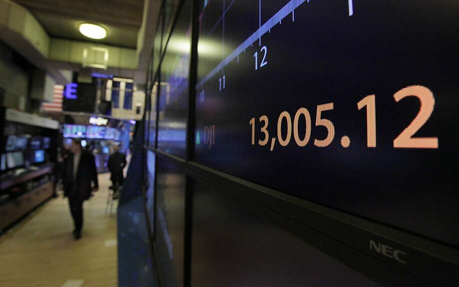 A board on the floor of the New York Stock Exchange shows the closing number for the Dow Jones Industrial average, Tuesday, Feb. 28, 2012. The Dow Jones industrial average closed above 13,000 Tuesday, the first time since May 2008, four months before the financial crisis. (AP Photo/Richard Drew) Photo: Richard Drew, Associated Press