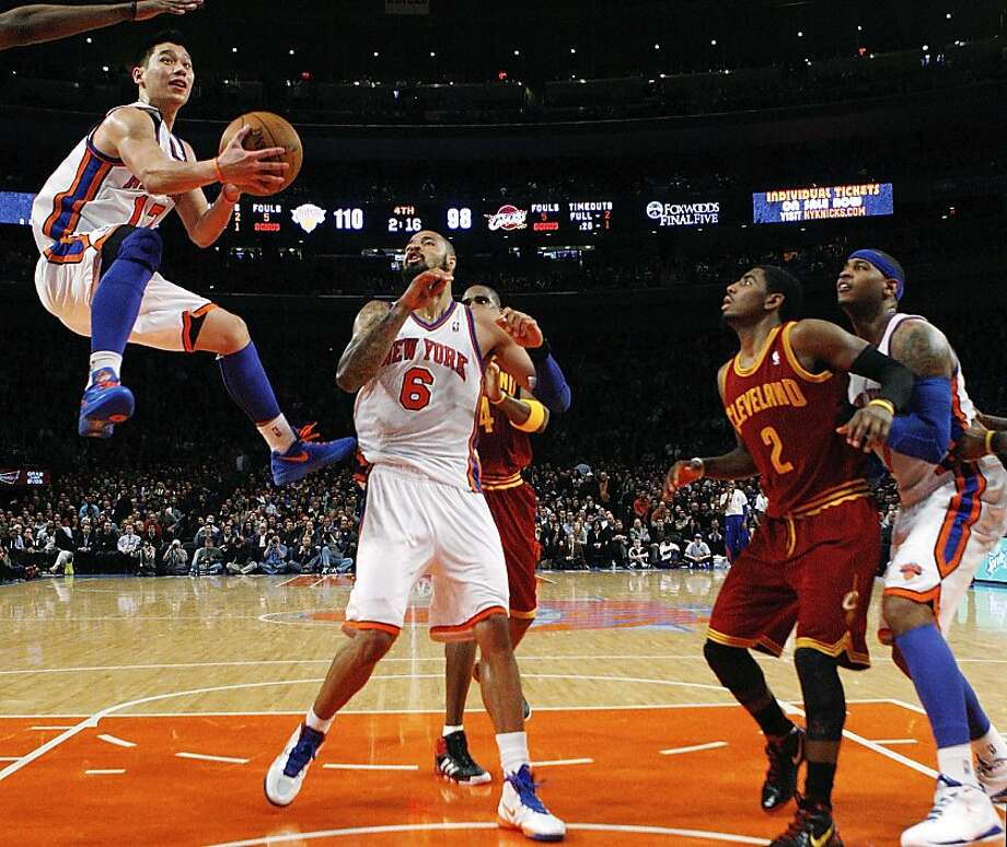 New York Knicks guard Jeremy Lin (17) shoots a layup past center Tyson Chandler (6), Cleveland Cavaliers forward Antawn Jamison (4), guard Kyrie Irving (2) and Knicks forward Carmelo Anthony (7) during the second half of the Knicks' 120-103 win in an NBA basketball game at New York's Madison Square Garden, Wednesday, Feb. 29, 2012. Photo: Kathy Willens, Associated Press