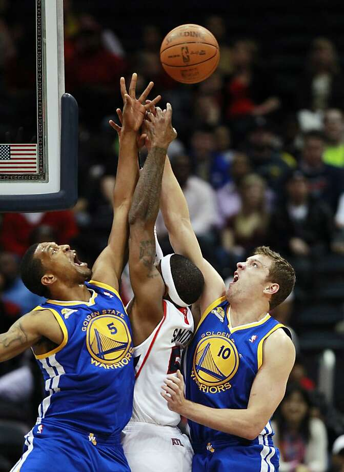 Golden State Warriors small forward Dominic McGuire (5) and power forward David Lee (10) battle Atlanta Hawks power forward Josh Smith (5) for a rebound in the first half of an NBA basketball game, Wednesday, Feb. 29, 2012, in Atlanta. The Warriors won 85-82. Photo: John Bazemore, Associated Press