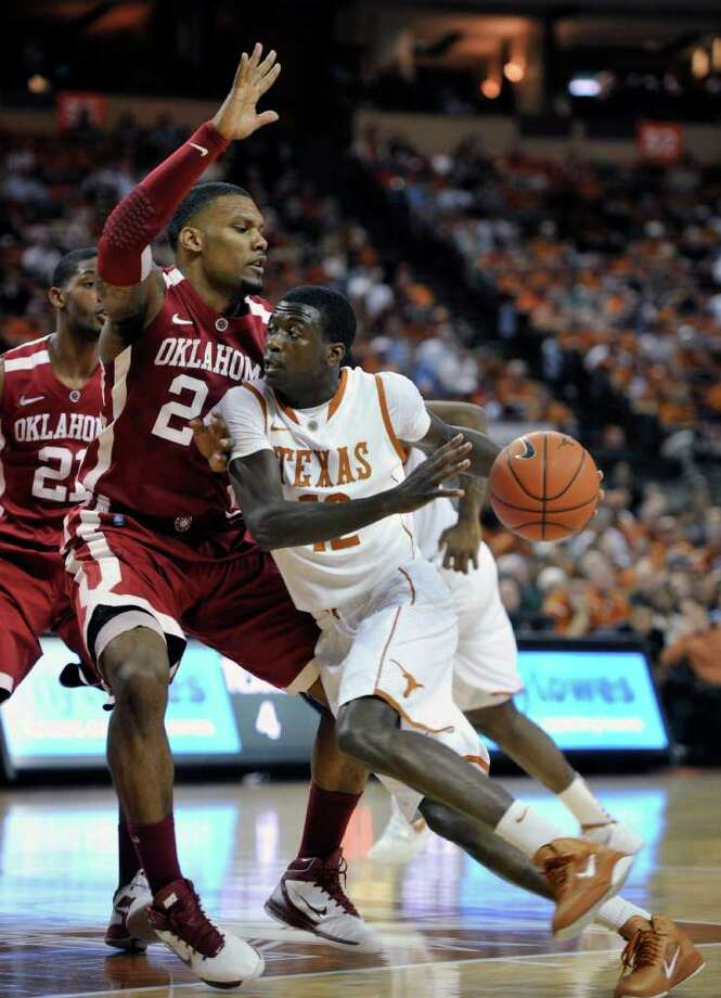 Texas guard Myck Kabongo, right, goes to the basket against Oklahoma forward Romero Osby. (AP Photo/Michael Thomas) Photo: Michael Thomas / FR65778 AP