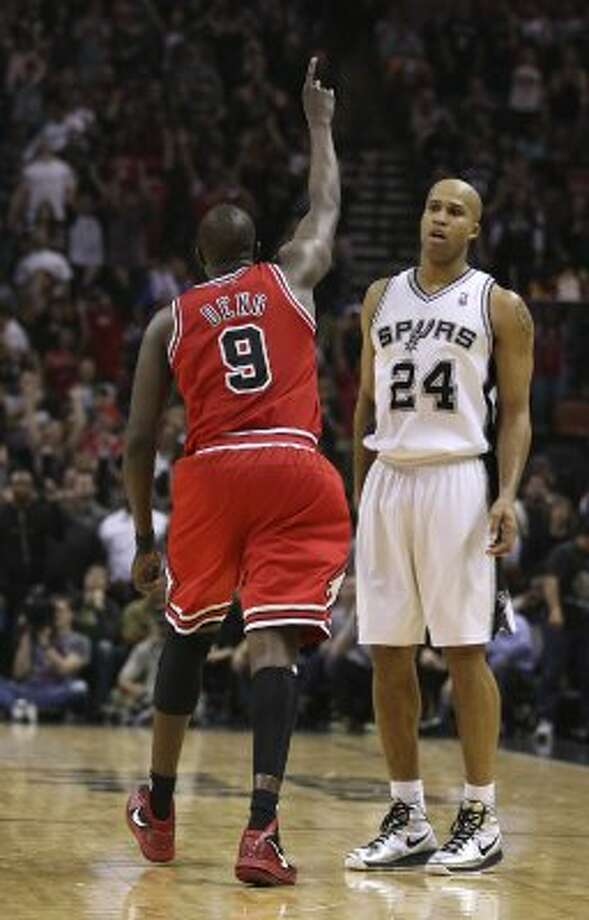 SPURS --  San Antonio Spurs Richard Jefferson looks on as Chicago Bulls Luol Deng celebrates a three-pointer with 39.6 seconds left in the game at the AT&T Center, Wednesday, Feb. 29, 2012. The Bulls won 96-89. Jerry Lara/San Antonio Express-News (San Antonio Express-News)