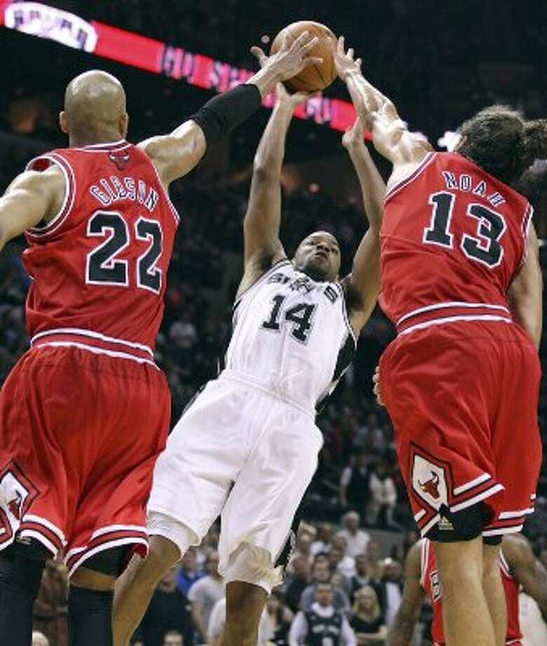 FOR SPORTS - San Antonio Spurs' Gary Neal shoots between Chicago Bulls' Taj Gibson (left) and Chicago Bulls'  Joakim Noah during second half action Wednesday Feb. 29, 2012 at the AT&T Center. The Bulls won 96-89. (PHOTO BY EDWARD A. ORNELAS/SAN ANTONIO EXPRESS-NEWS) (SAN ANTONIO EXPRESS-NEWS)