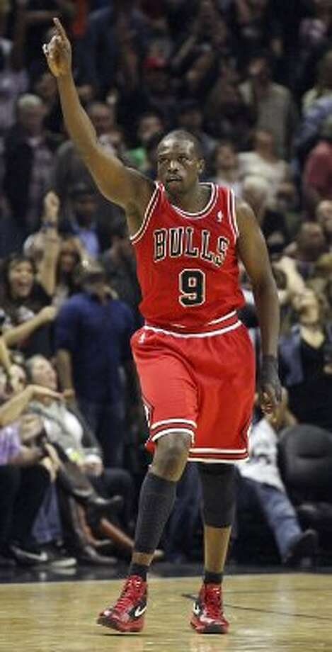 FOR SPORTS - Chicago Bulls' Luol Deng celebrates after making a 3-pointer late in the game with the San Antonio Spurs Wednesday Feb. 29, 2012 at the AT&T Center. The Bulls won 96-89. (PHOTO BY EDWARD A. ORNELAS/SAN ANTONIO EXPRESS-NEWS) (SAN ANTONIO EXPRESS-NEWS)