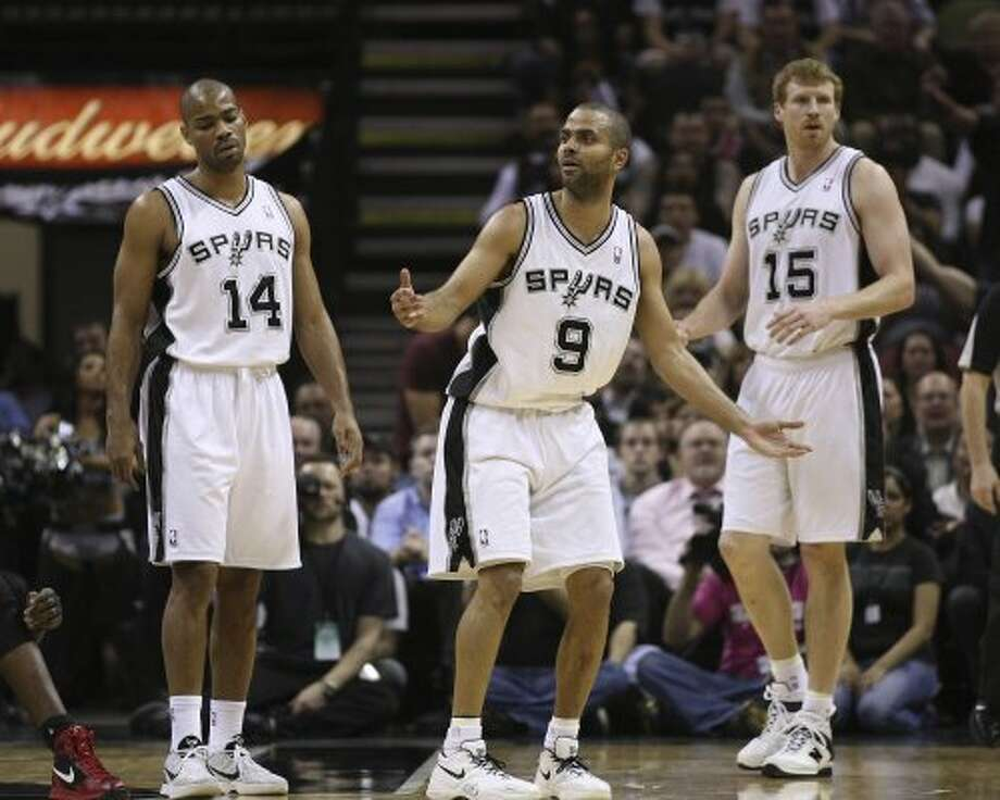 SPURS --  San Antonio Spurs from left, Gary Neal, Tony Parker and Matt Bonner protest a foul during the first half against the Chicago Bulls, at the AT&T Center, Wednesday, Feb. 29, 2012. Jerry Lara/San Antonio Express-News (San Antonio Express-News)