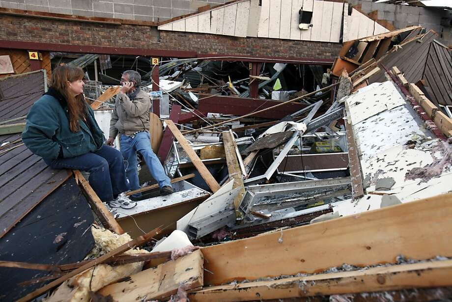 Sherry Cousins and her brother Bruce Wallace of Hollister, Mo., sit in the wreckage of their secondhand store in Branson, Mo, Wednesday, Feb. 29, 2012. A powerful storm system that produced multiple reports of tornadoes lashed the Midwest early Wednesday, roughing up the country music resort city of Branson. Photo: Mark Schiefelbein, Associated Press