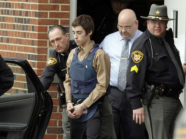 In this Tuesday, Feb. 28, 2012 photo, seventeen-year-old T.J. Lane is led from Juvenile Court by Sheriff's deputies in Chardon, Ohio, after his arraignment in the shooting of five high school students Monday. Three of the five students wounded in the attacks have since died. Photo: Mark Duncan, Associated Press