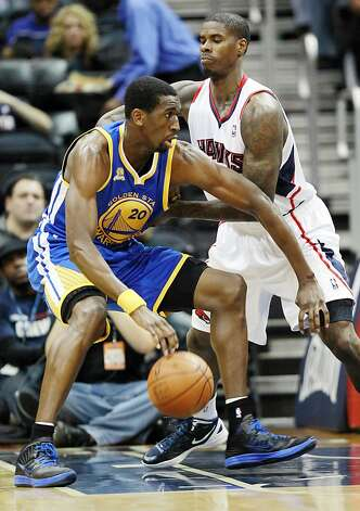 Golden State Warriors power forward Ekpe Udoh (20) drives against Atlanta Hawks small forward Marvin Williams (24) in the first half of an NBA basketball game, Wednesday, Feb. 29, 2012, in Atlanta. The Warriors won 85-82. Photo: John Bazemore, Associated Press