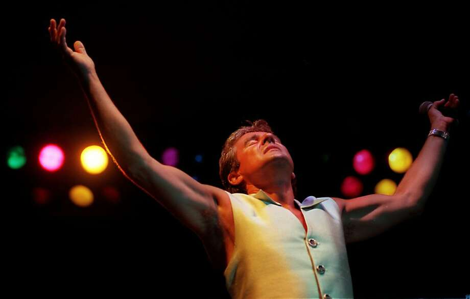 Monkees singer Davy Jones performs at the Doheny Days Music Festival at Doheny State Beach in 1997. Jones, the British Invasion-era singer who became a household heartthrob as a member of the Monkees, has died in Florida. He was 66. Photo: Allen Schaben, McClatchy-Tribune News Service