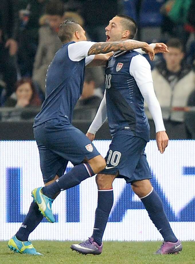 US midfielder Clint Dempsey, right,  celebrates with a teammate after scoring during a friendly soccer match between Italy and USA, at the Genoa Luigi Ferraris stadium, Italy, Wednesday, Feb. 29, 2012. USA won 1-0. (AP Photo/Tanopress) Photo: Tanopress, Associated Press