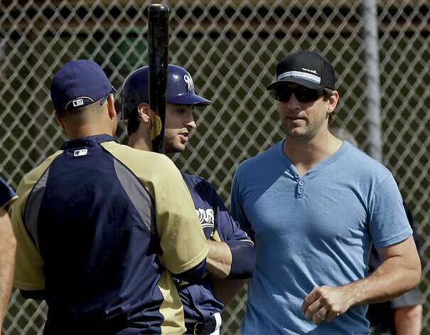 Milwaukee Brewers' Ryan Braun, center, and Aramis Ramirez, left, talk to Green Bay Packers quarterback Aaron Rodgers, during a spring training baseball workout Wednesday, Feb. 29, 2012, in Phoenix. (AP Photo/Morry Gash) Photo: Morry Gash, Associated Press