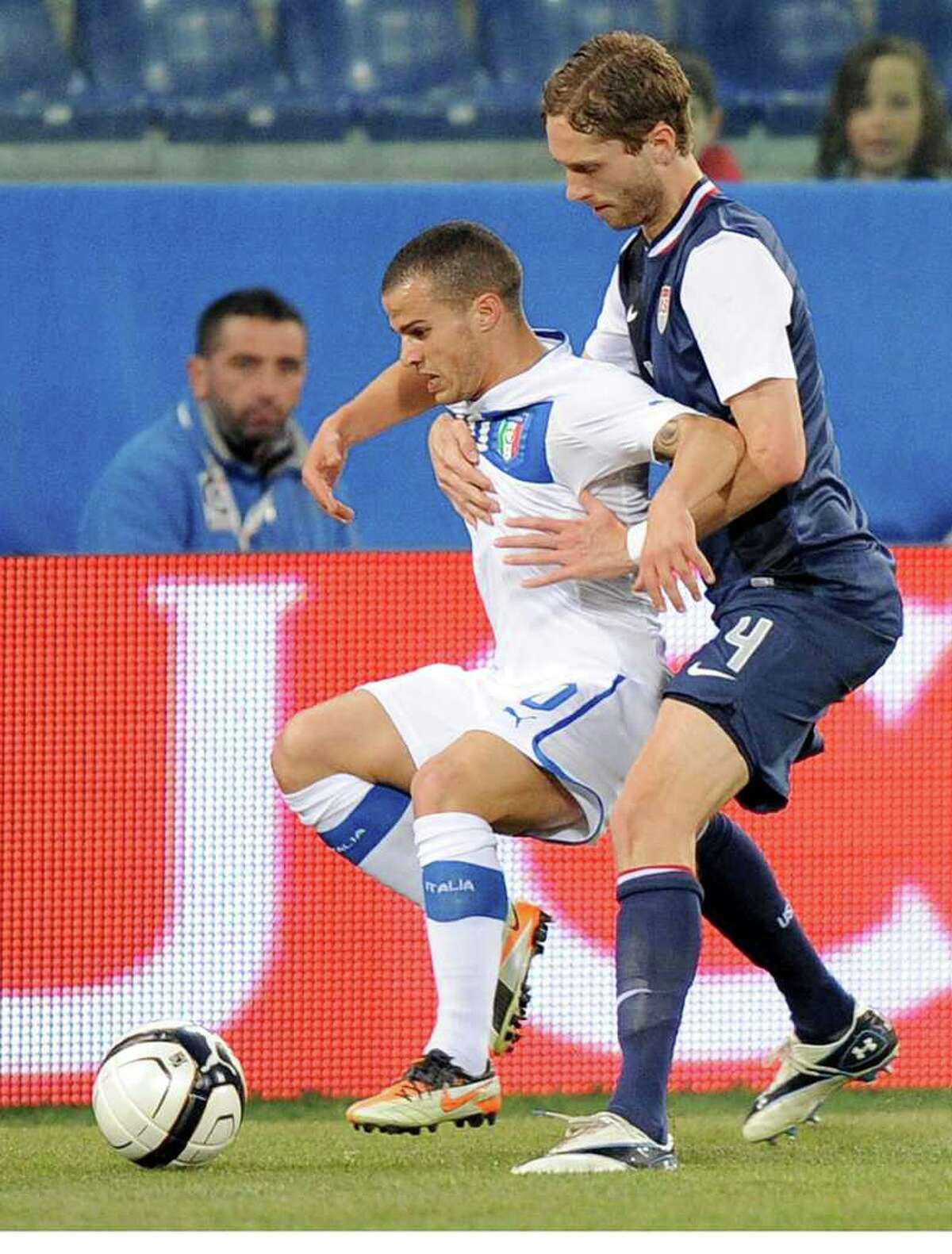 US defender Clarence Goodson, right, and Italy forward Sebastian Giovinco vie for the ball during a friendly soccer match between Italy and USA, at the Genoa Luigi Ferraris stadium, Italy, Wednesday, Feb. 29, 2012. USA won 1-0.