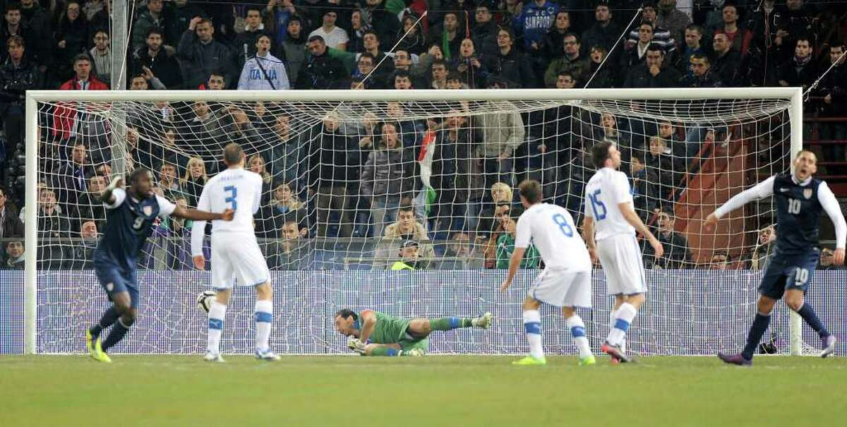 US midfielder Clint Dempsey, right, celebrates after scoring during a friendly soccer match between Italy and USA, at the Genoa Luigi Ferraris stadium, Italy, Wednesday, Feb. 29, 2012. USA won 1-0.