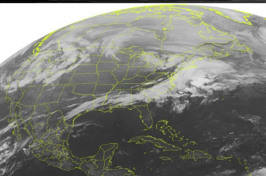 This NOAA satellite image taken Thursday, March 1, 2012 at 12:45 a.m. EST shows cloud cover over areas of Michigan through the Northeast as a storm system moves through the Upper Great Lakes.  Embedded within this cloud cover, areas of rain and snow form in parts of Michigan, while a mix of rain, ice pellets, and snow form in portions of the Northeast.  To the south, lines of showers and thunderstorms form ahead of an associated frontal boundary, in parts of the northern Gulf Coast states, the Southern and Central Appalachians, and the Mid-Atlantic.  (AP PHOTO/WEATHER UNDERGROUND) / WEATHER UNDERGROUND