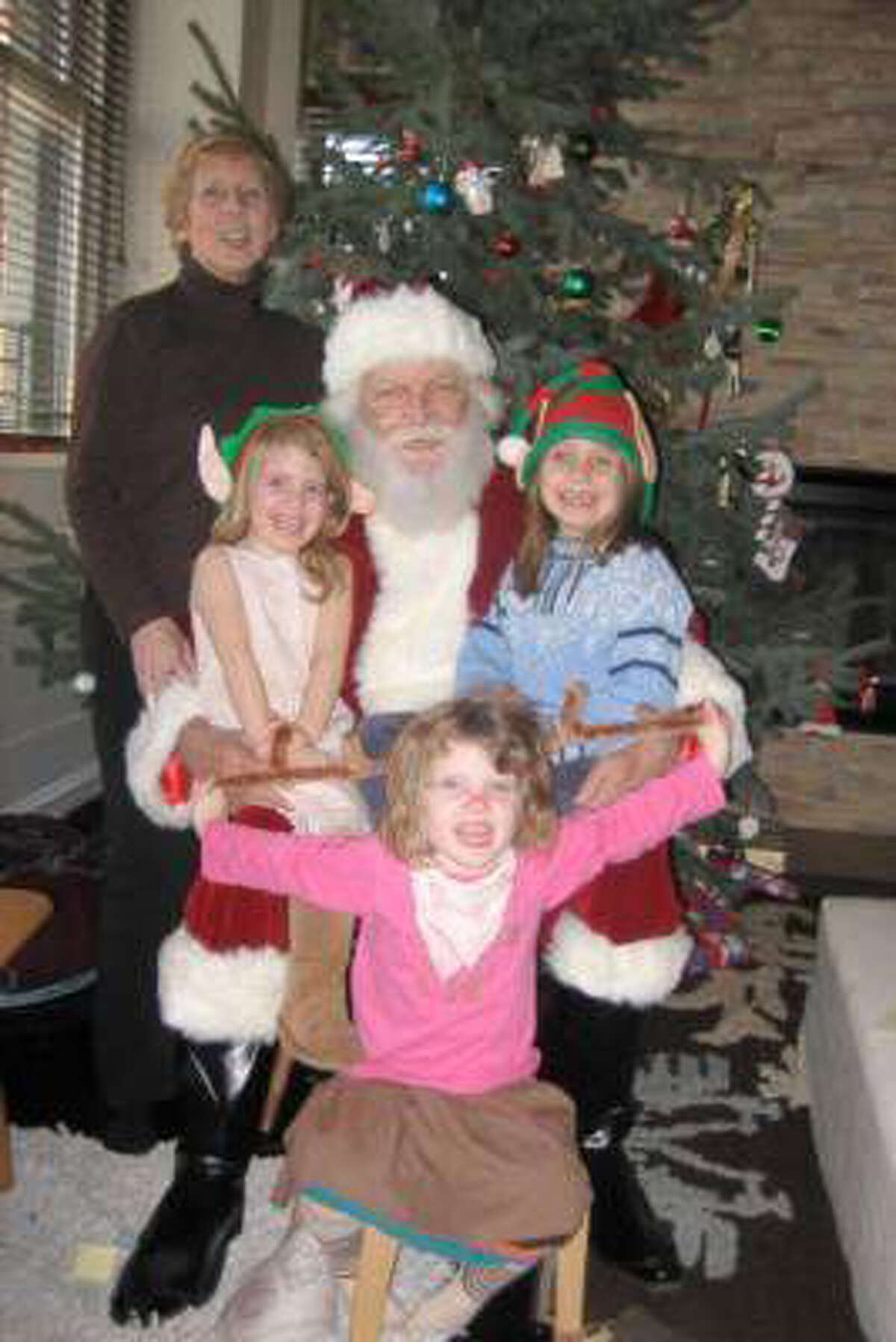 A photograph taken from the Web site gigmasters.com showing the five victims from a Christmas day fire in Stamford: Lomer Johnson, dressed as Santa; his wife, Pauline; and their granddaughters, Sarah, Grace, and Lily, left to right. (Courtesy of the Johnson family)