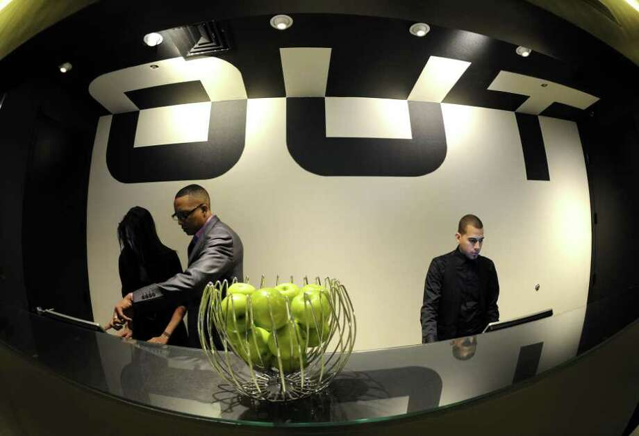 The front desk  of New York City's  first-ever gay hotel, The Out NYC, during the official opening to the public March 1, 2012.  The urban resort in  Hells Kitchen on 42nd Street will be the first hotel and entertainment complex targeted specifically at attracting the LGBT tourist and local community. Photo: TIMOTHY A. CLARY, AFP/Getty Images / AFP