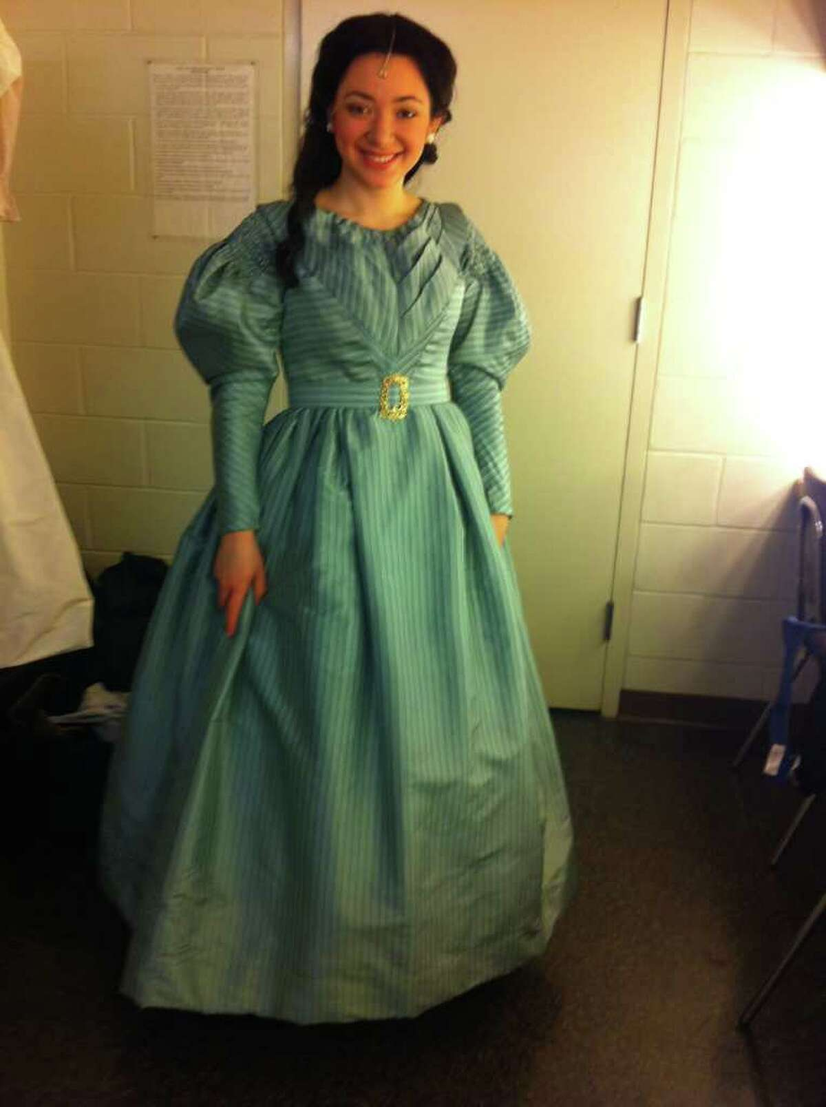 """Julie Benko of Fairfield is playing Cosette in the national tour of """"Les Miserables"""" arriving at the Bushnell in Hartford on March 6. Here she is seen backstage getting ready to go on in one of the earlier tour stops."""