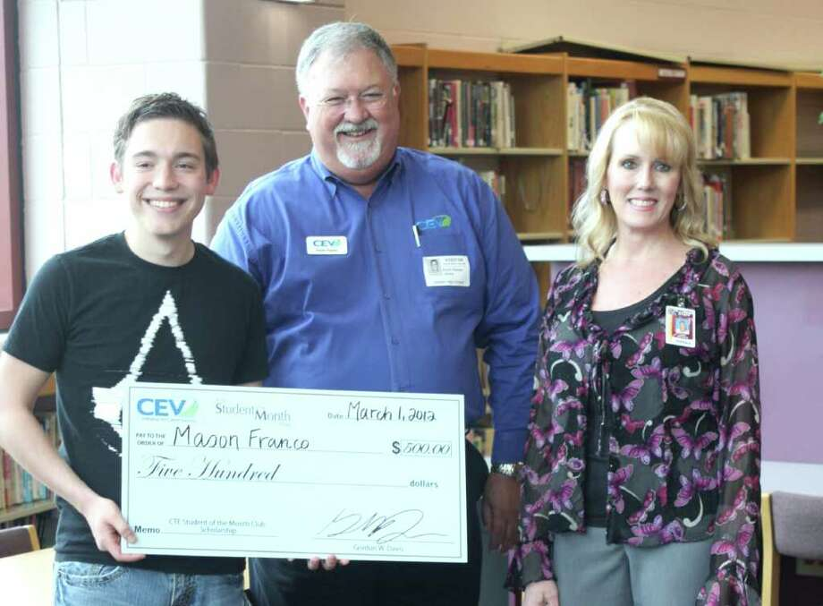 Silsbee High School senior Mason Franco, left, was surprised on Friday, Feb. 24 by CEV Multimedia Curriculum Consultant Kevin Parker, center, with a $500 scholarship award and announcement as the national company's CTE Student of the Month. Franco was nominated by his Video Technology/Broadcasting teacher, Corina Long, right. Photo: David Lisenby, HCN_Franco