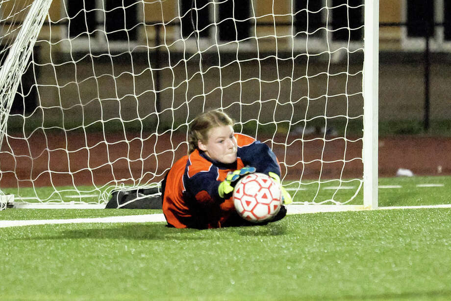 Lumberton goalie Makenzie Watts keeps the ball out of the net, denying an opponent the point. Watts has given up only three goals in the past three years of district play on the Lumberton Girls Varsity Soccer Team. Photo: Bruce Benson, HCN_Goalie
