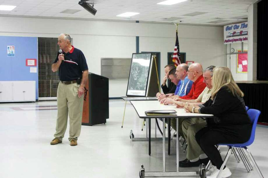 Lumberton Mayor Don Surratt, left, talks to attendees of a public hearing regarding the opening of Pine Burr and Williams Roads at their tie-in point on the new Forest Road, as Council member look on. Photo: David Lisenby, HCN_Road Meeting