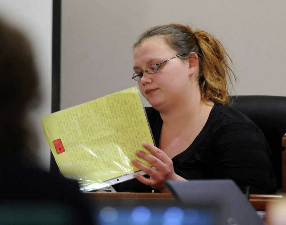Loretta Colegrove reads a poem sent to her by Matthew Slocum while she testifies during his trial in Washington County Court in Fort Edward, N.Y. March 1, 2012.     (Skip Dickstein / Times Union archive) Photo: SKIP DICKSTEIN / 2011