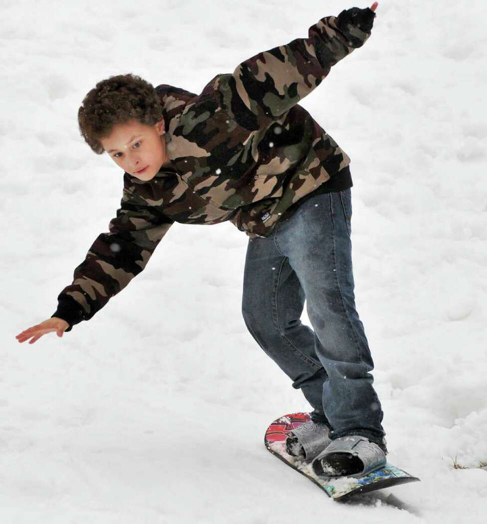 Nine-year-old Tyler Harris of Albany practices his snowboarding at Albany's Swinburne Park Thursday March 1, 2012. (John Carl D'Annibale / Times Union)