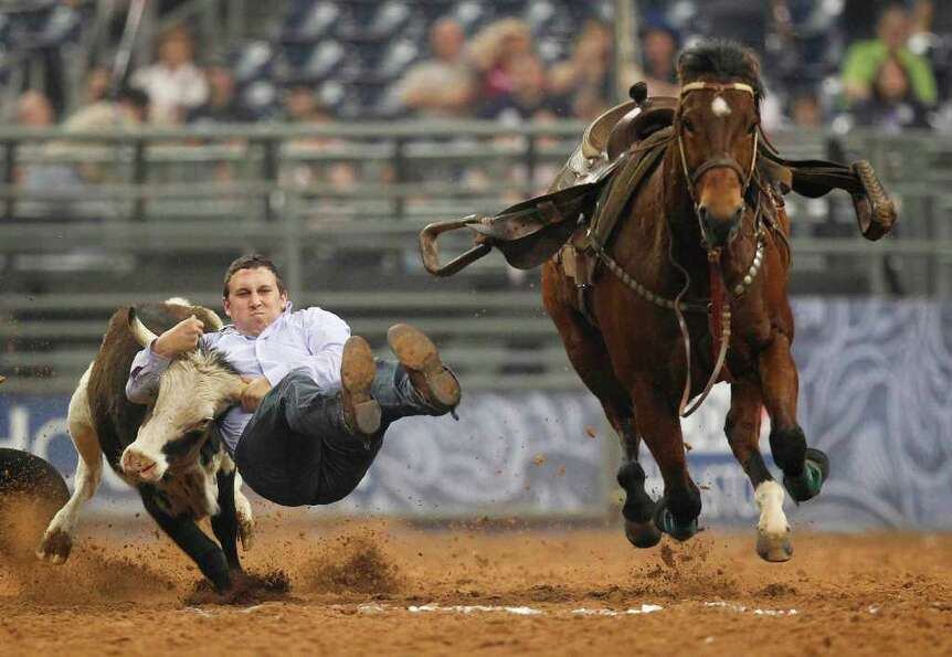 Riley Duvall competes in Steer Wrestling during the Rodeo Houston BP Super Series I Round 2 at Relia
