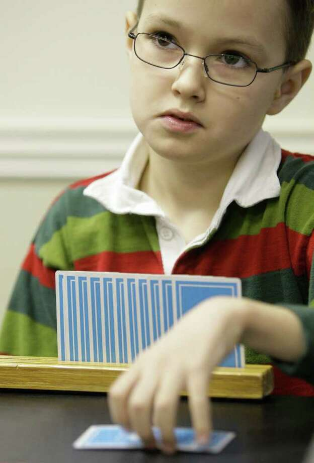 Zach Garrison, 9, recently achieved the title of Life Master of the American Contract Bridge League at a regional tournament in Houston. Photo: Melissa Phillip / © 2011 Houston Chronicle