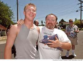 ** FILE ** Brian Nygard Bekowsky, right, is shown with his son, Mick R. Nygardbekowsky, left, Saturday, July 26, 2003, during a celebration in Concord, Calif., welcoming Mick home from a six month tour in Iraq. Nygardbekowsky was one of seven Marines killed this week in a suicide-bomb attack west of Baghdad. Nygardbekowsky was on his second deployment in support of Operation Iraqi Freedom, according to a statement from Camp Pendleton. (AP Photo/Contra Costa Times, Karl Mondon) NO SALES MAGS OUT MANDATORY CREDIT,NO SALES