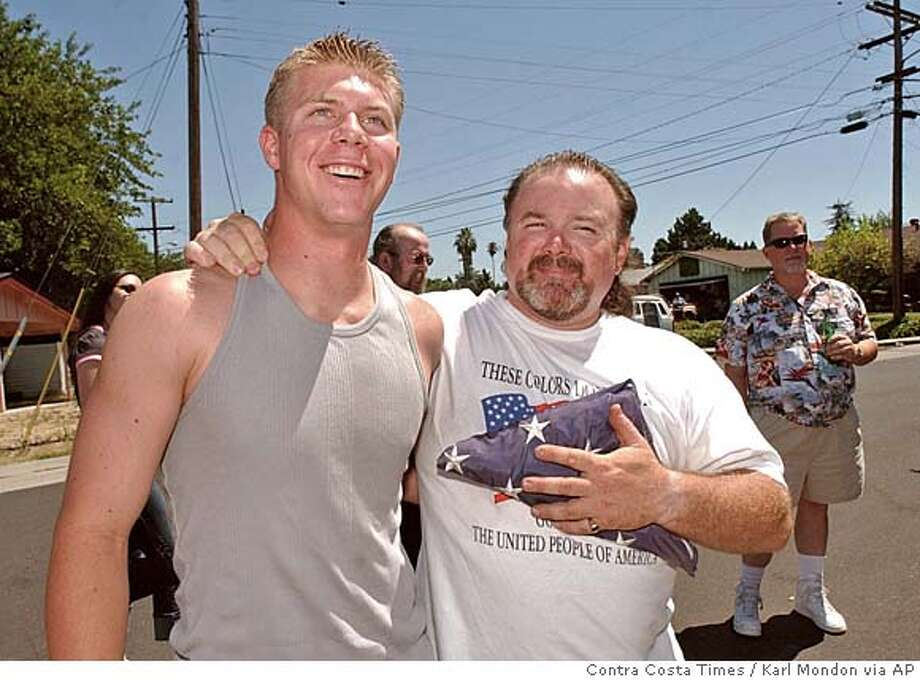 ** FILE ** Brian Nygard Bekowsky, right, is shown with his son, Mick R. Nygardbekowsky, left, Saturday, July 26, 2003, during a celebration in Concord, Calif., welcoming Mick home from a six month tour in Iraq. Nygardbekowsky was one of seven Marines killed this week in a suicide-bomb attack west of Baghdad. Nygardbekowsky was on his second deployment in support of Operation Iraqi Freedom, according to a statement from Camp Pendleton. (AP Photo/Contra Costa Times, Karl Mondon) NO SALES MAGS OUT MANDATORY CREDIT,NO SALES Photo: KARL MONDON