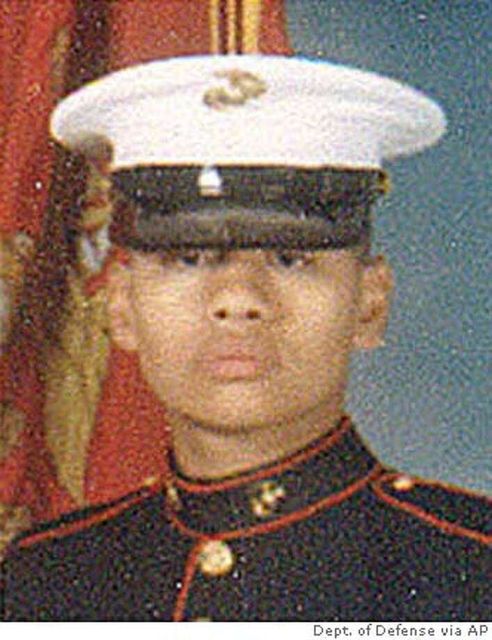 U.S. Marine Lance Cpl. Andrew S. Dang, 20, of Foster City, Calif., was killed Monday, March 22, 2004, by hostile fire near Ar Ramady, Iraq. Dang was assigned to 1st Combat Engineer Battalion, 1st Marine Division, I Marine Expeditionary Force bassed at Camp Pendleton, Calif. (AP Photo/Dept of Defense via San Jose Mercury News) UNDATED PHOTO BEST QUALITY AVAILABLE,NO SALES Photo: AP