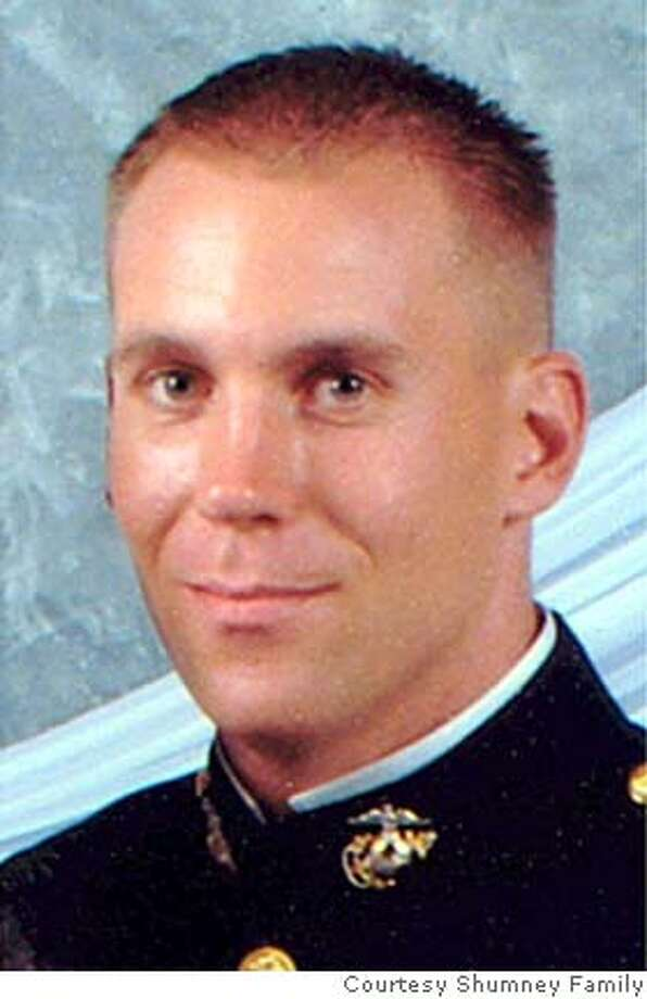 ** FILE ** This March 13, 2004, photo provided by the family showing U.S. Marine 1st Lt. Dustin M. Shumney of Vallejo, Calif., who was killed in a helicopter crash near Ar Rutbah, Iraq, Jan. 26, 2005. (AP Photo/Family photo via the Dallas Morning News) NO SALES, MAGS OUT; A MARCH 13, 2004 FAMILY PHOTO Photo: AP