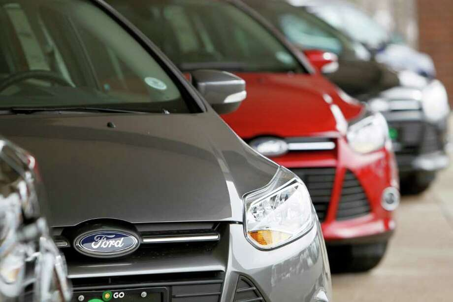This Feb. 19, 2012 photo,  shows a line of 2012 Focus sedans at a Ford dealership in the south Denver suburb of Littleton, Colo. Ford Motor Co. said Thursday, March 1, 2012, its U.S. sales rose 14 percent in February thanks to big demand for its Focus compact car. Photo: AP