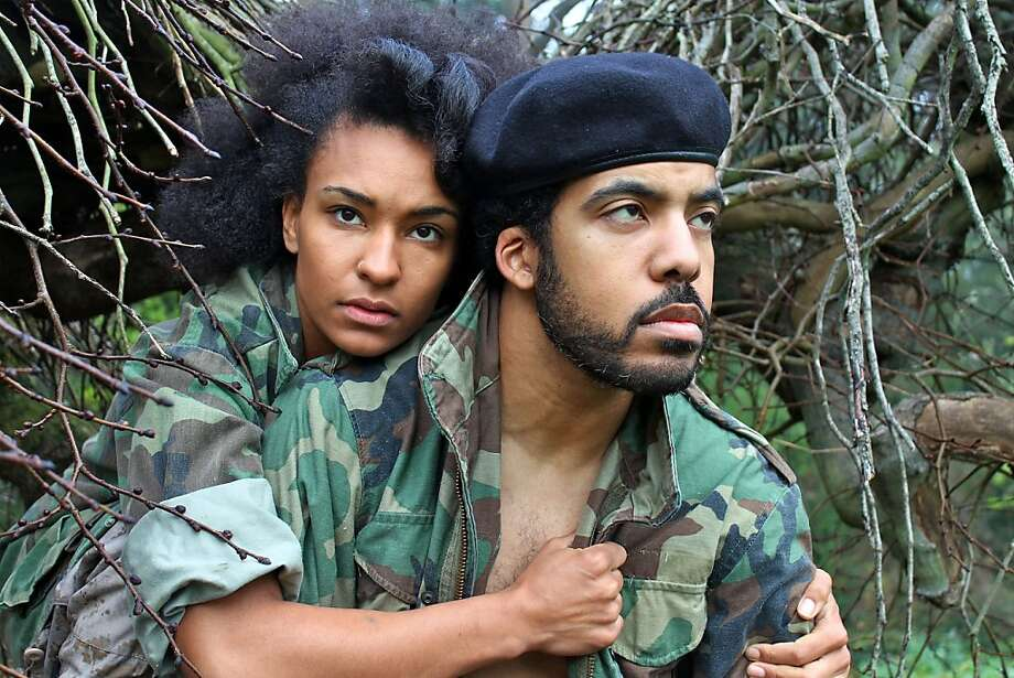 Portia (Tristan Cunningham) and Brutus (David Moore) share a moment in the wilds of West Africa in African-American Shakespeare Company's Julius Caesar. Photo: L. Peter Callender