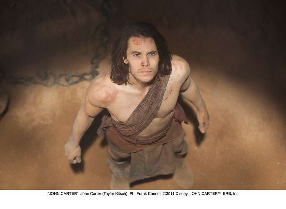 """Taylor Kitsch in the title role in the film """"John Carter,"""" based on the book by Edgar Rice Burroughs. """"JOHN CARTER""""  John Carter (Taylor Kitsch)  Ph: Frank Connor  ©2011 Disney. JOHN CARTERª ERB, Inc. Photo: Disney"""
