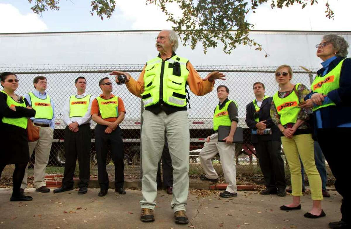 """About 40 people came to follow Burden on a """"walkability audit"""" of Navigation Bldvd. Outside the Original Ninfa's on Navigation, we were handed bright yellow safety vests. Right now, walking on Navigation really does seem that dangerous. (Cody Duty / Houston Chronicle)"""