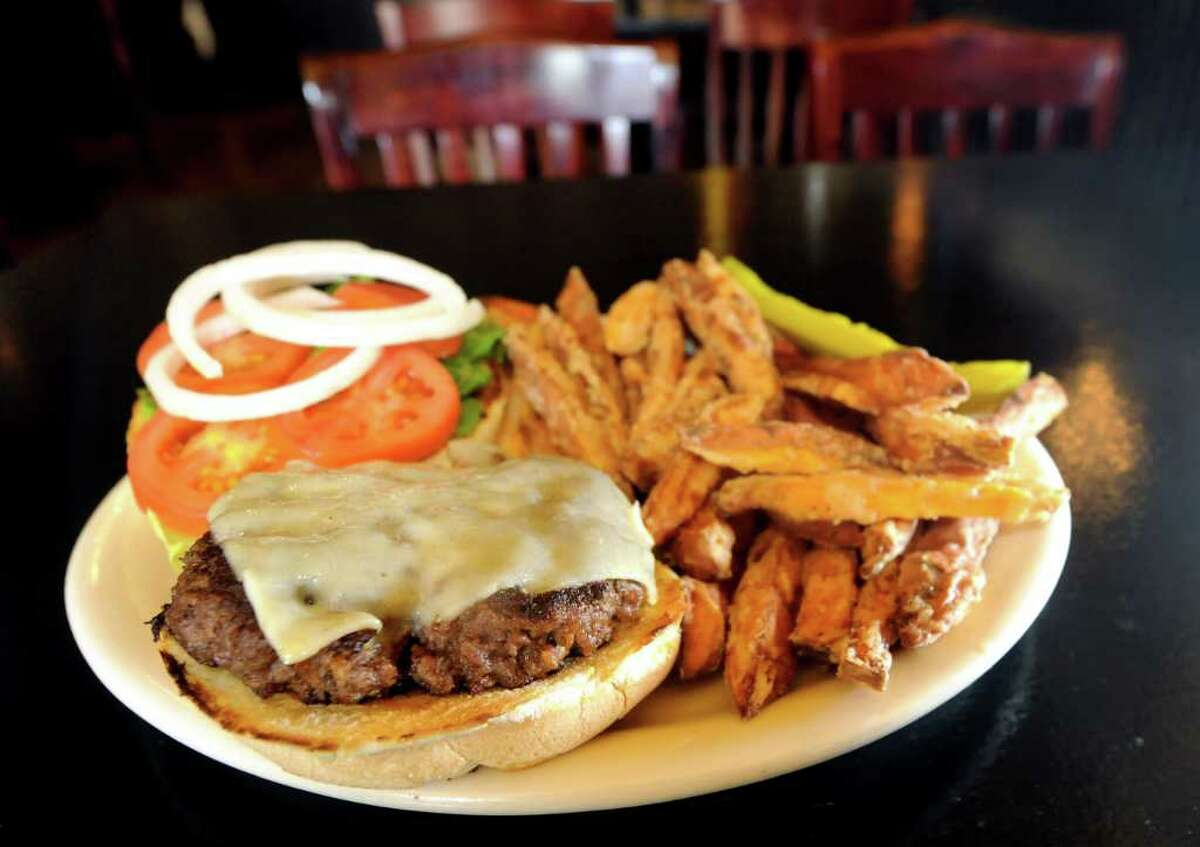 Broadway Burger with cheddar cheese and sweet potato fries at Broadway Brew on Tuesday, Feb. 28, 2012, in Troy, N.Y. (Cindy Schultz / Times Union)