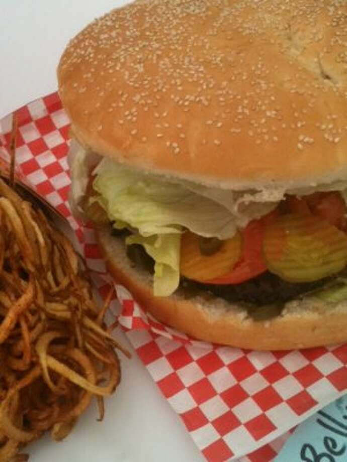 Who's ready for a giant burger and french fries that could feed a small town? Check out this burger from RodeoHouston 2012.