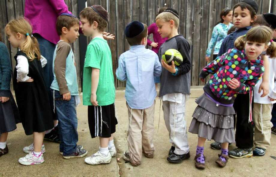 Kindergartners at Torat Emet, Jewish school line up outside the school on their way in from recess on Thursday, Feb. 16, 2012, in Houston. The Orthodox Union in New York is pitching Houston as a more affordable place, with a tight knit Orthodox community exists, for Orthodox Jews to live. ( Brett Coomer / Houston Chronicle ) Photo: Brett Coomer / © 2012 Houston Chronicle