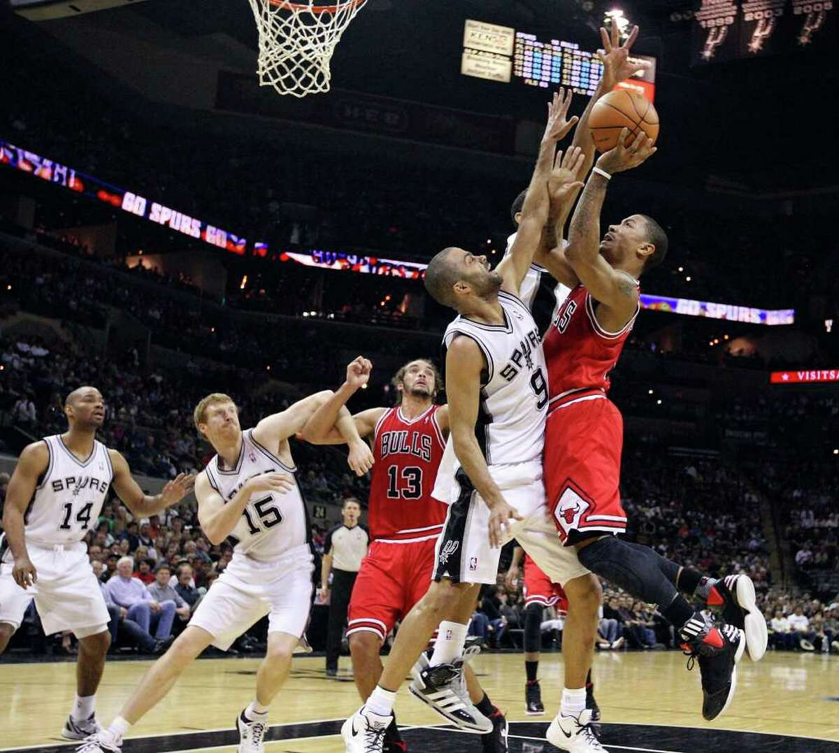 Chicago Bulls' Derrick Rose shoots over San Antonio Spurs' Tony Parker during first half action Wednesday Feb. 29, 2012 at the AT&T Center.