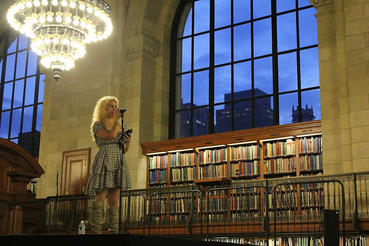Jane McGonigal giving a welcoming speech at the New York Public Library on May 20, 2011. She created Find The Future: The Game, a series of quests played at the Library s landmark 42nd Street building and online. Five hundred gamers chosen by McGonigal and NYPL were given access to the stacks overnight to play the game.
