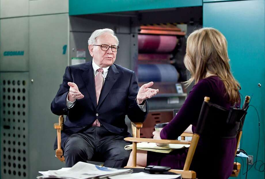 "Billionaire inverstor Warren Buffett chairman and CEO of Berkshire Hathaway, is interviewed by Becky Quick, co-host of CNBC's ""Squawk Box,"" on the floor of the Omaha World-Herald's press room Monay  Feb. 27,  2012, in Omaha Neb. Buffett said Monday that stocks remain relatively cheap compared to other investments as the economy continues to improve. He also said that the company he heads is prepared to replace him whenever the need arises. (AP Photo/The Omaha World-Herald, Jeff Beiermann)  ALL TV OUT, MAGS OUT Photo: Jeff Beiermann, Associated Press"