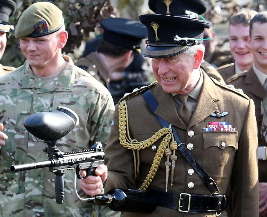 Can't wait to try this out on the paparazzi!The Prince of Wales fires a paintball gun to celebrate St. David's Day, Wales' national holiday, as he visits with the 1st Battalion The Welsh Guards in Hounslow. Photo: Steve Parsons, Associated Press