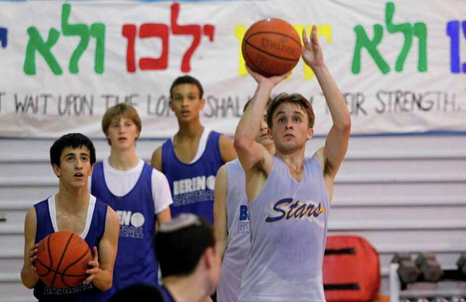 Senior Isaac Mirwis, 18, and teammates practiced earlier this week at Robert M. Beren Academy. Photo: Mayra Beltran / © 2012 Houston Chronicle