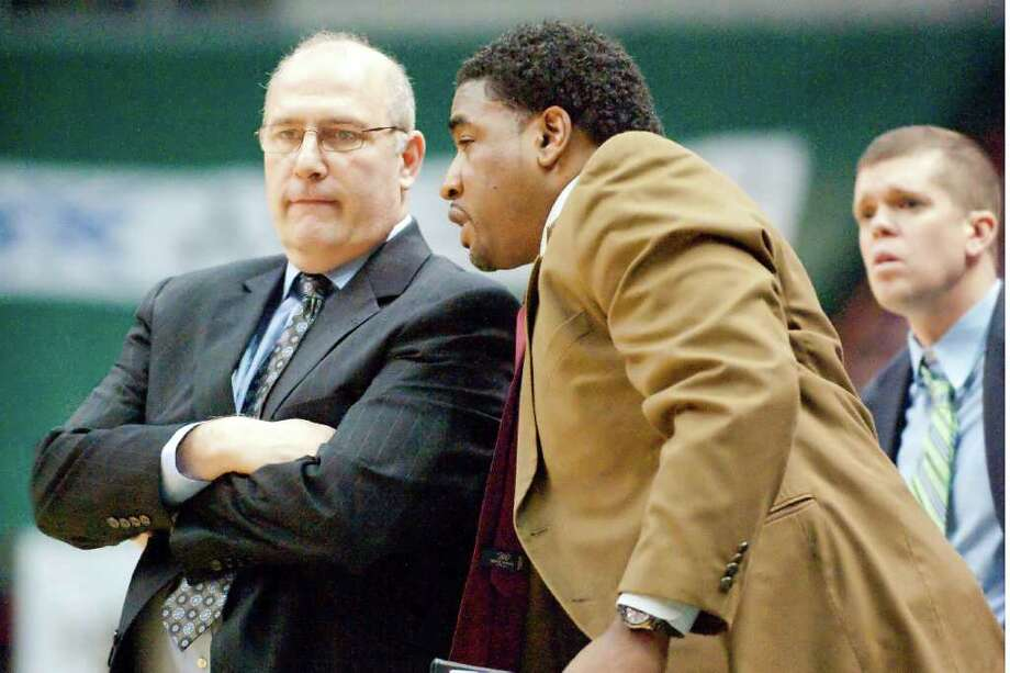 COURTESY SIENA SIENA COACH Mitch Buonaguro, left, talks with assistant coach Craig Carter, the only one who returned from last year?s staf. The new assistants helped the Saints deal with a rash of player losses.
