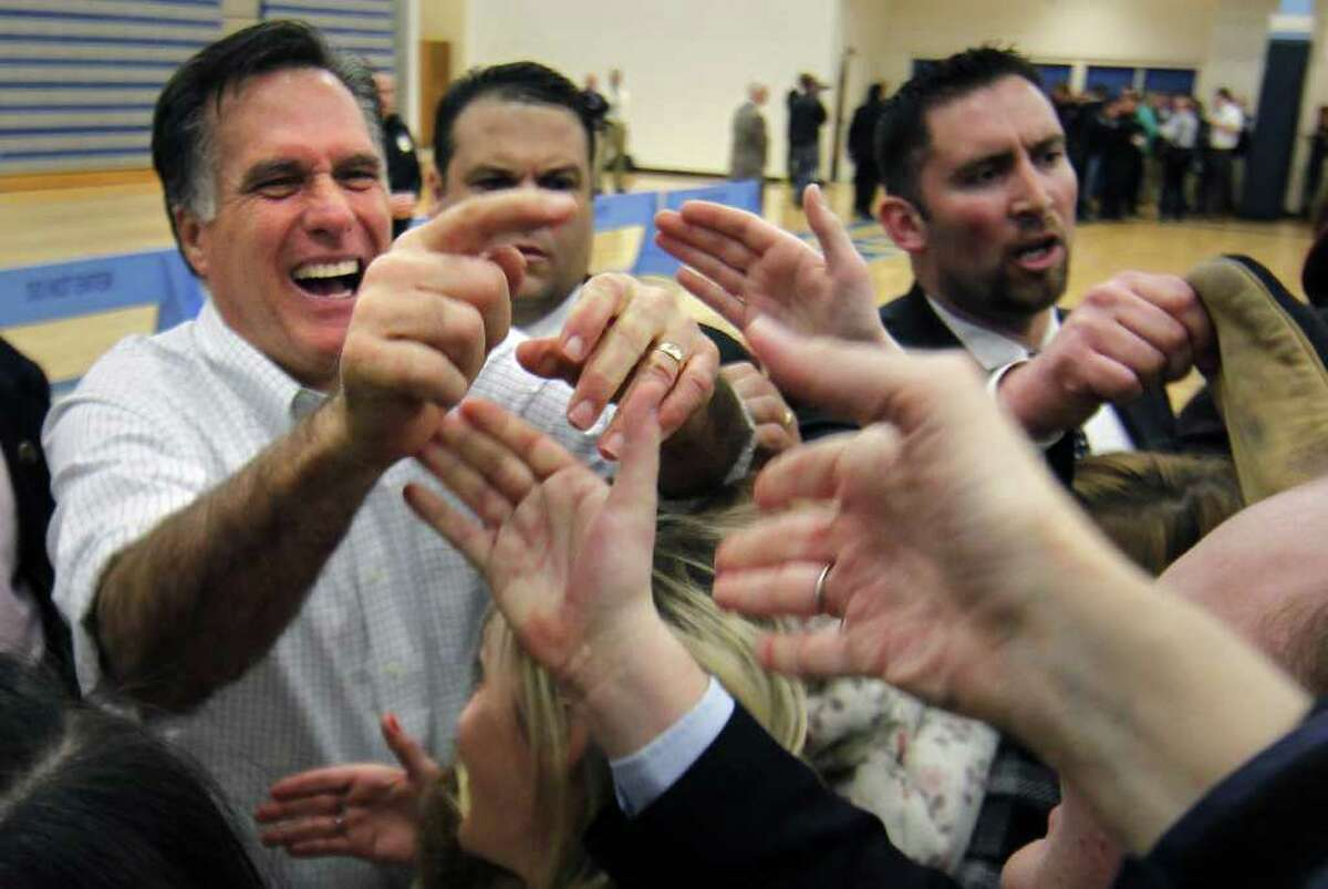 Republican presidential candidate, former Massachusetts Gov. Mitt Romney greets overflow supporters in a second gymnasium after speaking at a campaign rally at Skyline High School in Idaho Falls, Idaho, Thursday, March 1, 2012. (AP Photo/Gerald Herbert)