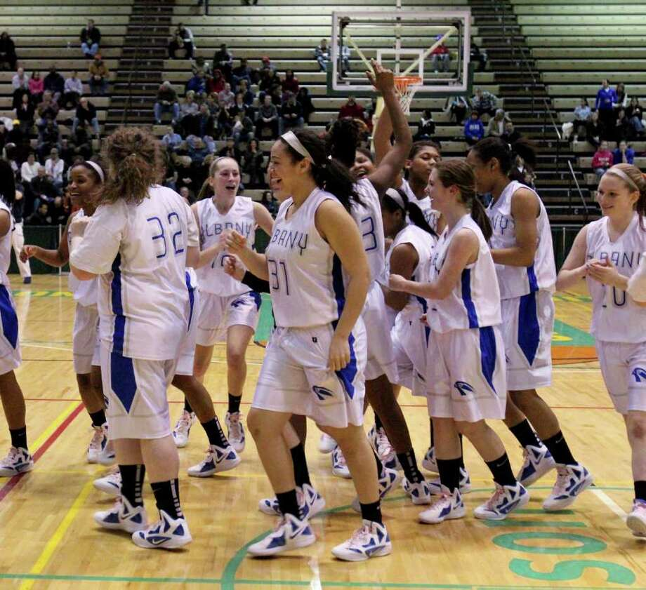 The Albany Lady Falcons celebrate after winning a Class AA girls' semifinals game between Albany High School and Shenendehowa High School at Hudson Valley Community College, Troy, on Thursday, March 1, 2012. (Erin Colligan / Special To The Times Union)